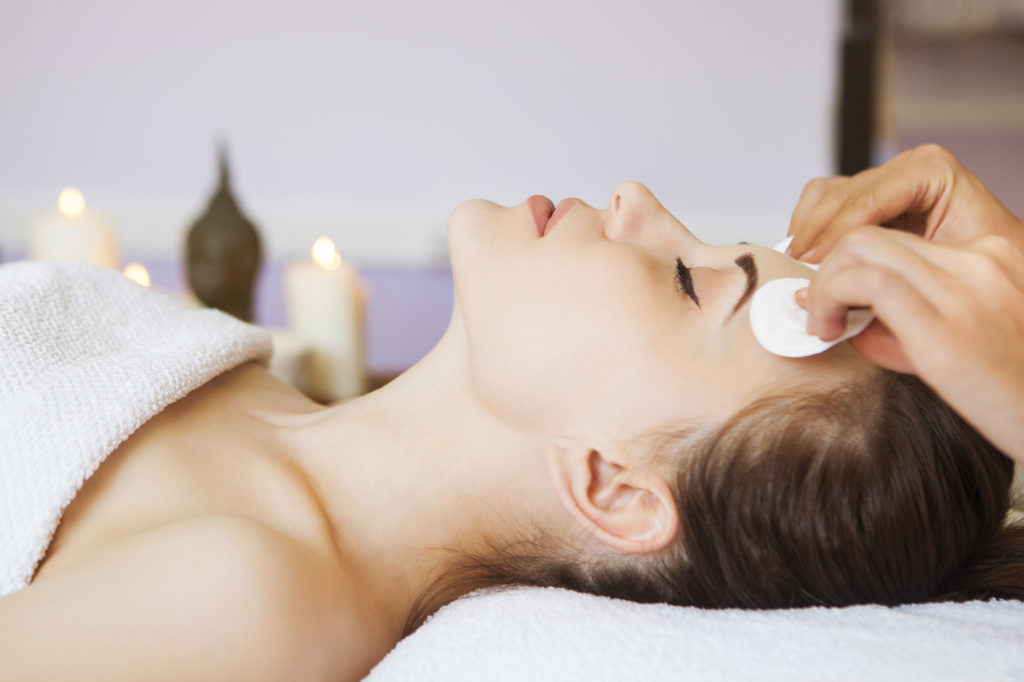 woman getting a facial at a spa